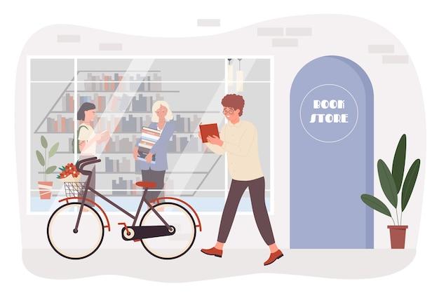 La gente nello studente del lettore del negozio di libri che cammina accanto alla parte anteriore dell'edificio della libreria
