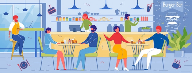 Persone che si godono il cibo e il tempo libero nel burger bar.