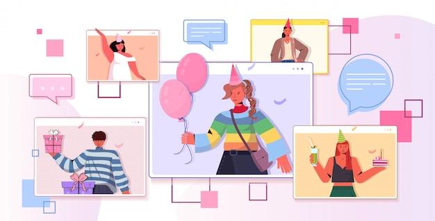 Persone in cappelli festivi che celebrano la festa di compleanno online