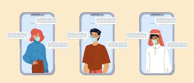 Persone in maschera di comunicazione tramite chat video mobile