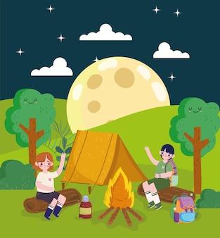 Persone in campeggio notturno