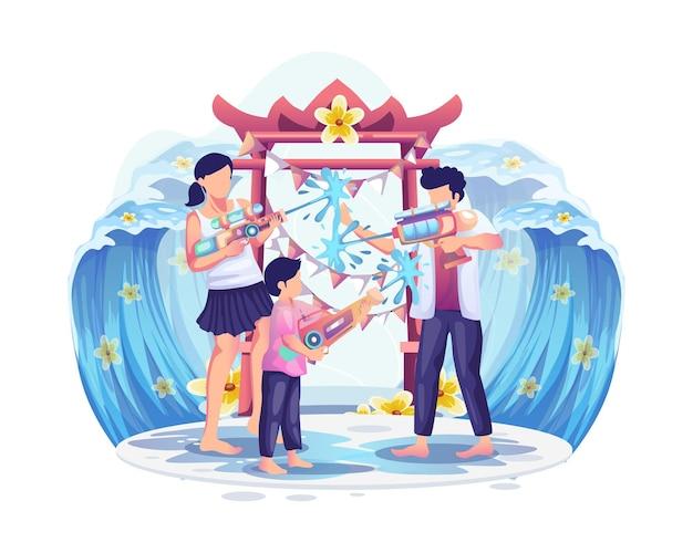 Persone che giocano pistola ad acqua nel festival di songkran, thailandia tradizionale illustrazione di capodanno