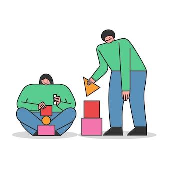 Persone che giocano con mattoni da costruzione creando da blocchi colorati costruzioni astratte e figure