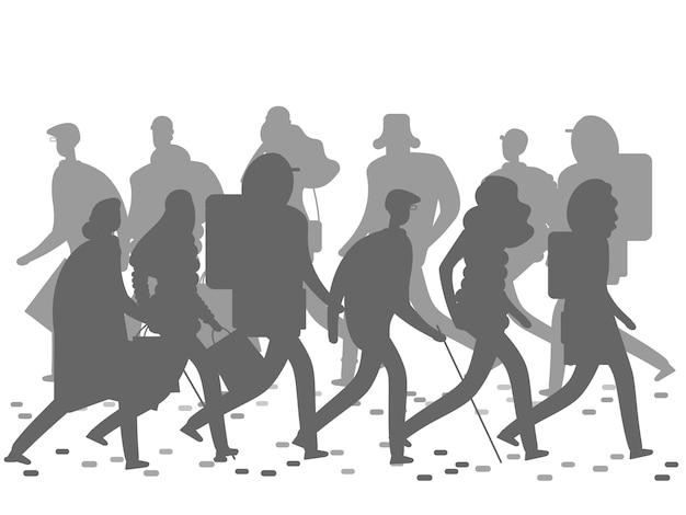 Sagome di persone che camminano sulla strada d'inverno o in autunno.