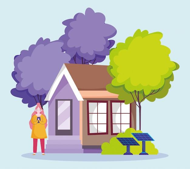 Persone e smartphone, donna che usando il cellulare della casa eco con cartone animato pannello solare