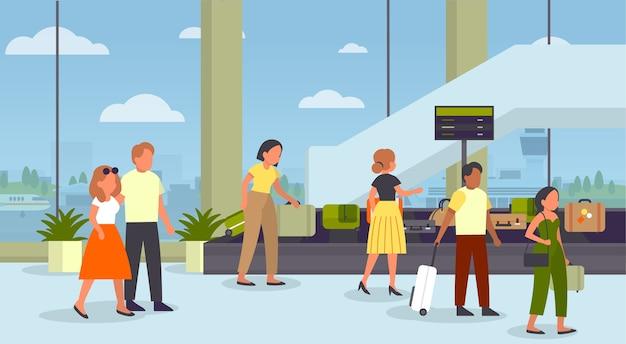 Persone in piedi in aeroporto al nastro trasportatore di bagagli per prendere la loro valigia. controllo della scansione di sicurezza dei bagagli. interno dell'aeroporto.