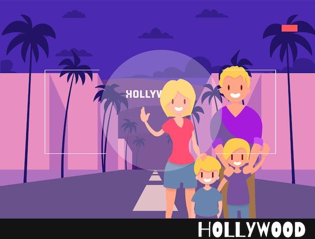 Le persone in piedi vengono fotografate sullo sfondo di hollywood. illustrazione di viaggio nello stile della fotografia. famiglia con bambini sullo sfondo di los angeles.