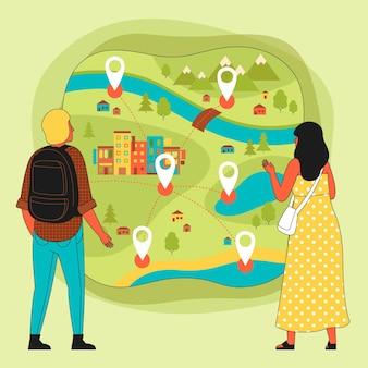 Le persone che utilizzano una mappa del turismo locale concetto