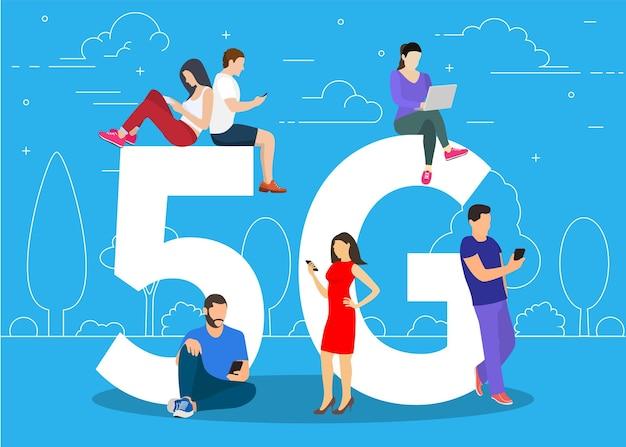 Persone con gadget seduti sul grande simbolo 5g.