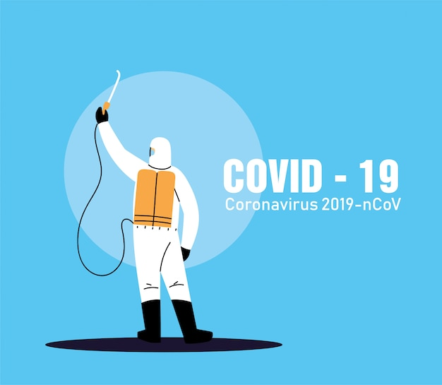 Persona in tuta per lavorare sulla disinfezione di covid-19