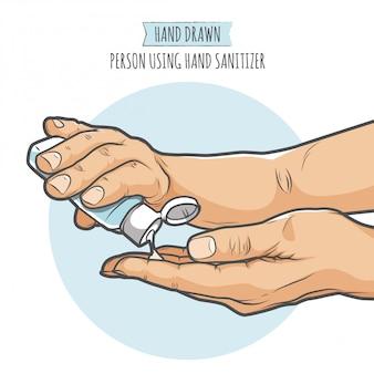 Persona che utilizza disinfettante per le mani