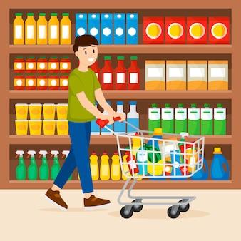 Persona con carrello pieno di generi alimentari