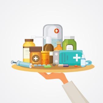 Concetto di farmacia con capsule di pillole. la mano del medico tiene il vassoio con i farmaci.