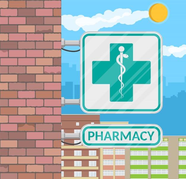 Segno della farmacia sulla parete. Vettore Premium