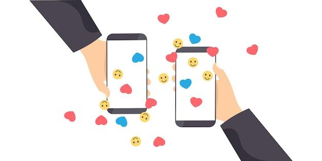 Telefono in mano con cuori e sorrisi
