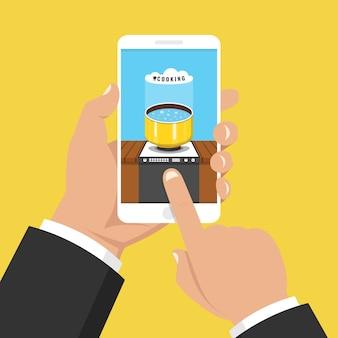Telefono con app di cottura sullo schermo