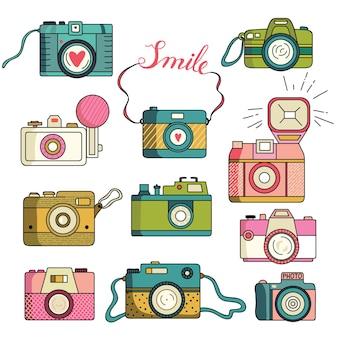 Le macchine fotografiche della foto hanno impostato la raccolta variopinta Vettore Premium