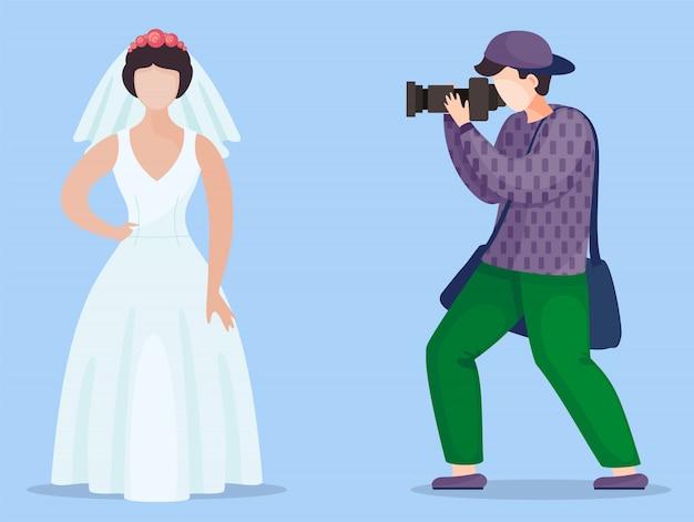 Fotografo che fa foto del modello in abito da sposa con velo