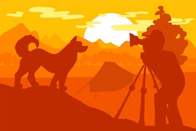 Il fotografo fotografa il cane che cammina nel campo della montagna della foresta. tenda sotto l'albero. scena della natura mattutina. paesaggio delle colline. panorama turistico. vettore