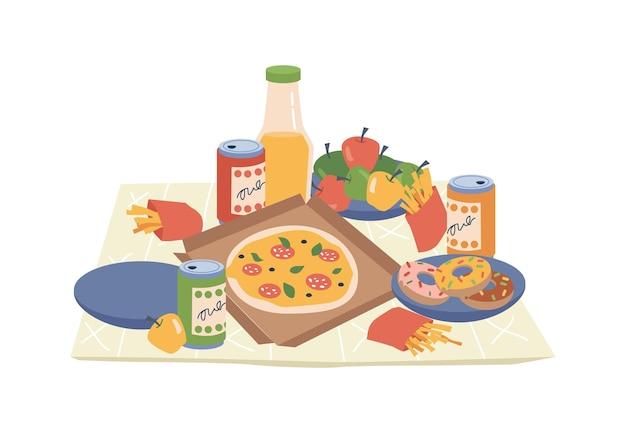 Cibo da picnic su snack e verdure da fastfood in coperta
