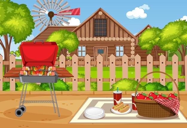 Scena pic-nic con cibo sul tavolo e barbecue in giardino