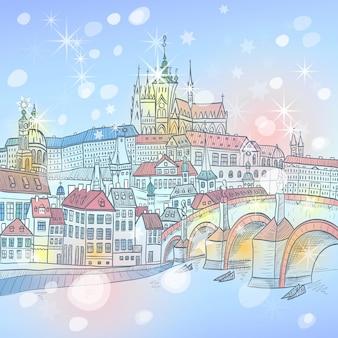 Pittoresca vista invernale del paesaggio di praga di natale con il castello di praga e il ponte carlo
