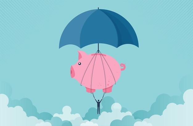 Salvadanaio con concetto di ombrello che solleva un uomo d'affari fino al successo per la gestione e gli investimenti
