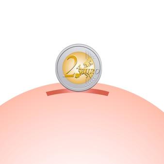 Salvadanaio con moneta da due euro