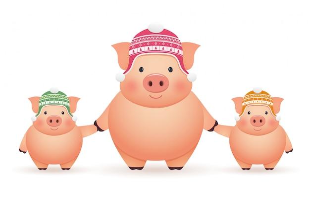 Suini in berretti su sfondo bianco. capodanno cinese del maiale.