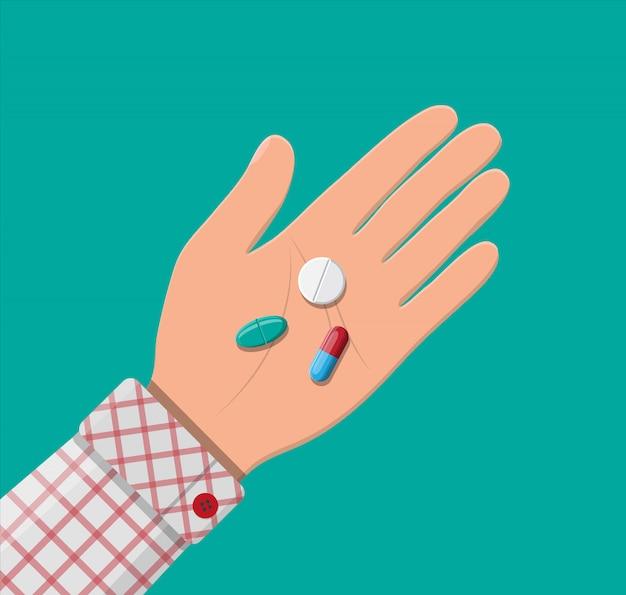 Pillole per malattia e trattamento del dolore in mano