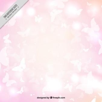 Sfondo rosa di farfalle bianche