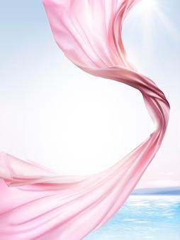 Elementi in chiffon rosa, panno volante su sfondo oceano