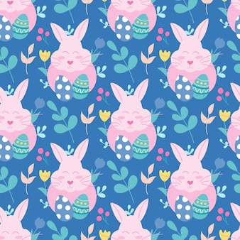 Coniglietto di pasqua rosa con uova e piante su sfondo blu. reticolo senza giunte.
