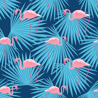 Fenicotteri rosa e foglie di palma. modello estivo tropicale senza soluzione di continuità.