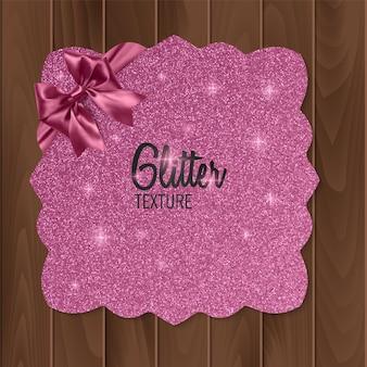 Sfondo rosa, glitter con fiocco realistico. biglietto d'auguri.