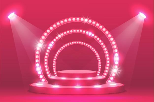 Palco podio rosa con luci a rampa, scena dello spettacolo