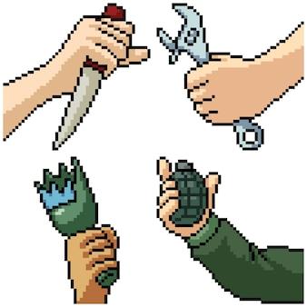 Pixel art set isolato mano che tiene l'arma