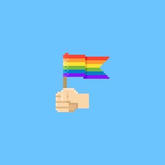 Mano di pixel che tiene bandiera arcobaleno Vettore Premium