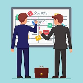 Programma di pianificazione sul concetto di scheda attività. planner, calendario sulla lavagna. lavoro di squadra, collaborazione
