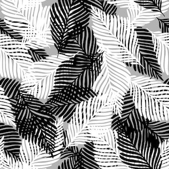 Reticolo senza giunte tropicale della foglia di palma della pianta. fondo in bianco e nero astratto. concept design tessile alla moda in tessuto