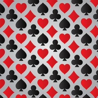 Modello di semi delle carte da gioco su sfondo grigio