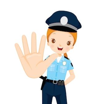 La poliziotta alza la mano per fermarsi