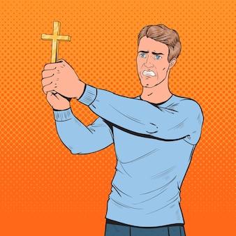 Pop art uomo impaurito che difende dalla violenza con la croce