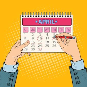 Data del calendario di pianificazione della mano dell'uomo d'affari di pop art.