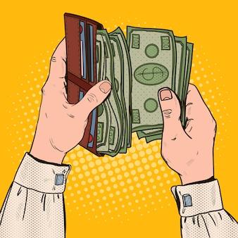 Mani dell'uomo d'affari di pop art che tengono portafoglio con soldi