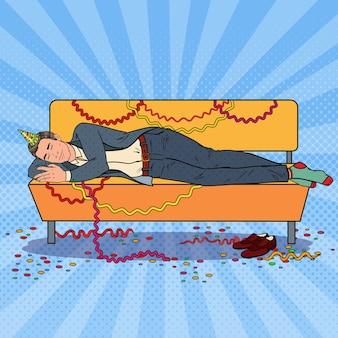Uomo d'affari di pop art che dorme sul divano dopo la festa in ufficio aziendale. celebrazione del nuovo anno, compleanno.