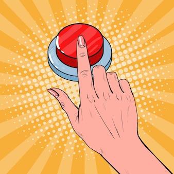 Mano femminile di pop art che spinge un pulsante rosso