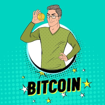 Pop art handsome man holding golden bitcoin coin. crypto valuta concetto. poster pubblicitario di denaro virtuale.