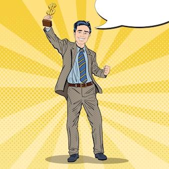 Pop art happy businessman holding golden winners cup. successo aziendale. illustrazione