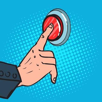 Mano maschile pop art premendo un grande pulsante rosso